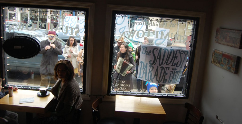 The parade as seen from inside Gusto Café on Cabot Street.
