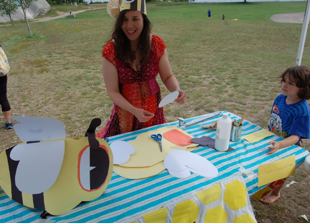 Kari Percival leads bee hat-making workshop at Cape Ann Farmers' Market on July 2, 2015.