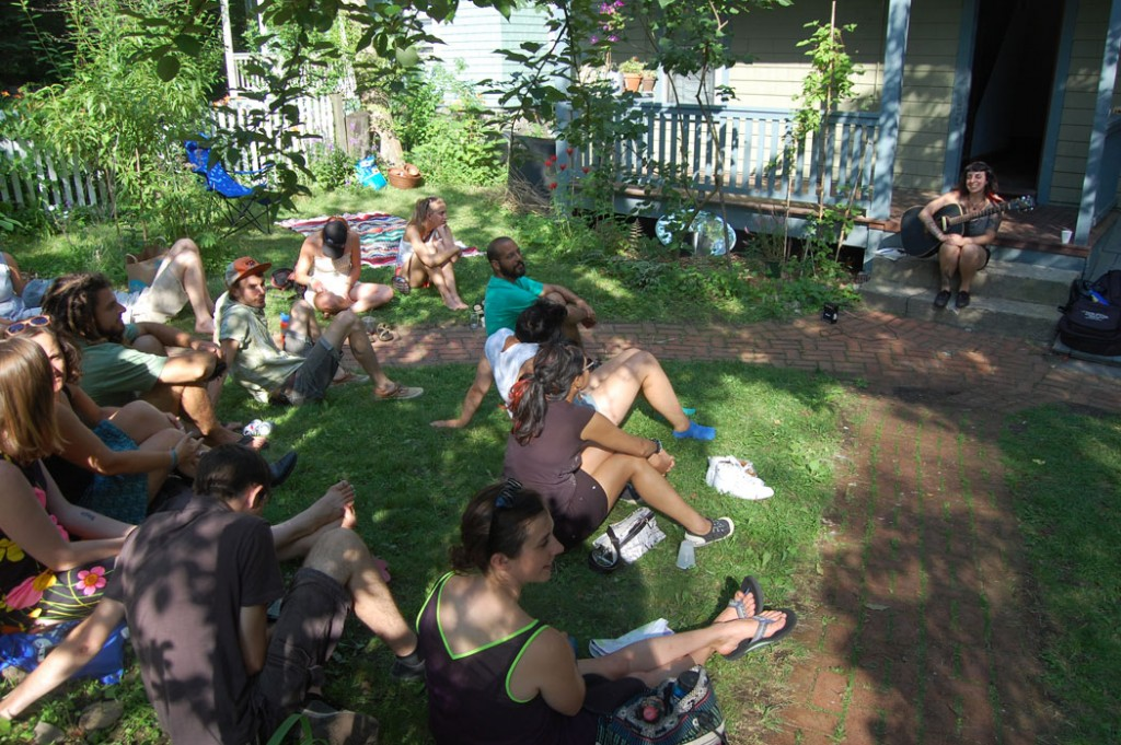 Kelly Dogtooth plays at 255 Chestnut Ave. during the 2015 Jamaica Plain Porchfest. (©Greg Cook photo)