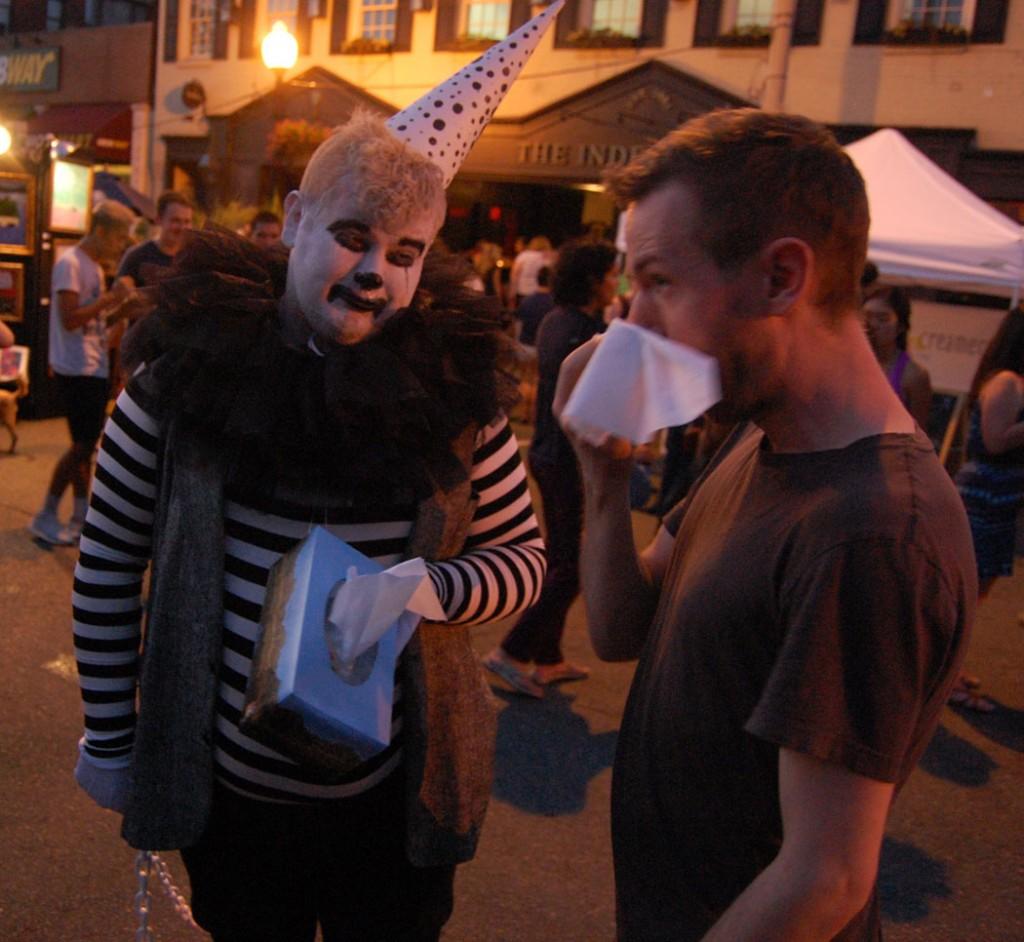 Drabby The Sad Clown (Tom Bush) offers an attendee a tissue.