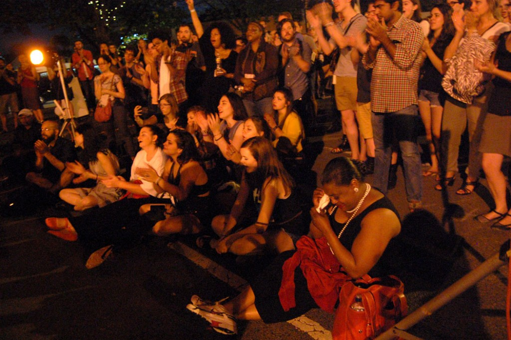 The Somerville Pity Party crowd applauds Grace Givertz, as her mother (foreground) is brought to tears. (Greg Cook)
