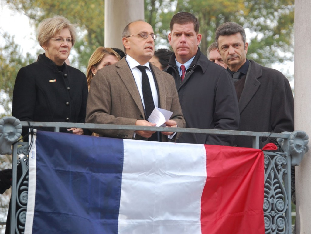Valéry Freland, consul general of France in Boston, speaks at the rally. He was joined on the bandstand by Massachusetts Sen. Elizabeth Warren (left) and Boston Mayor Marty Walsh. (Greg Cook)