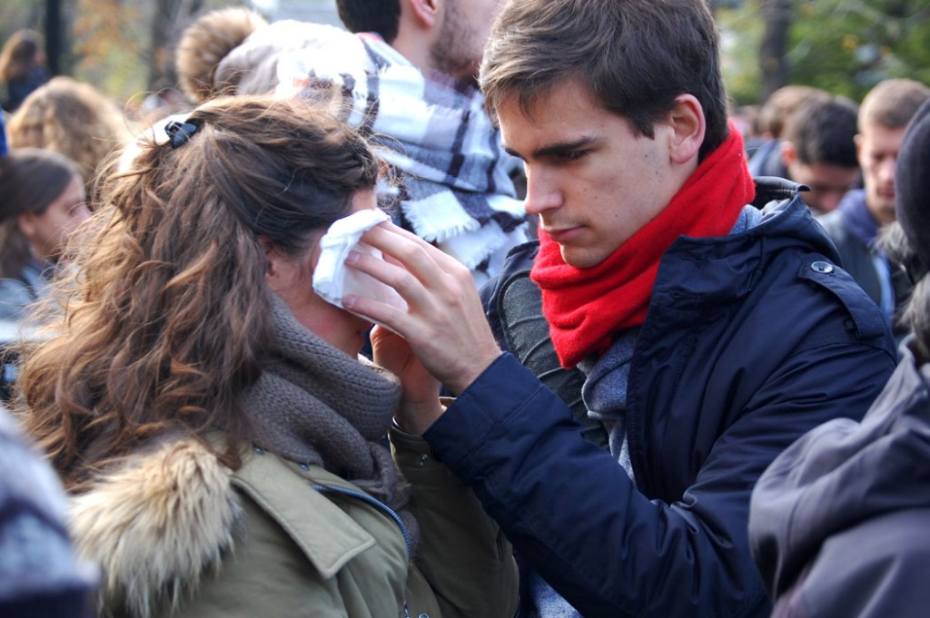 A man wipes away a woman's tears. (Greg Cook)