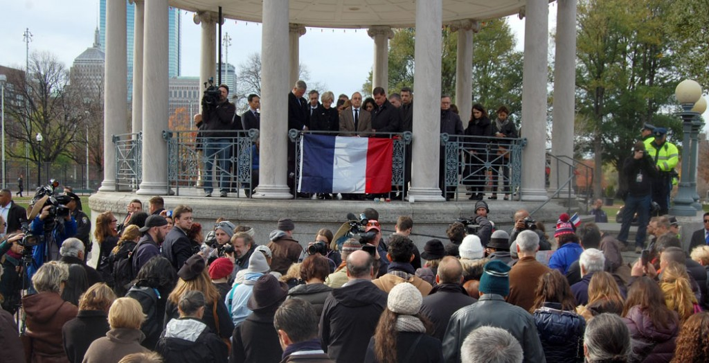 Valéry Freland, consul general of France in Boston, standing at center on the Parkman Bandstand leads a moment of science. He was joined on the bandstand by Massachusetts Gov. Charlie Baker, Mass. Sen. Elizabeth Warren, and Boston Mayor Marty Walsh. (Greg Cook)