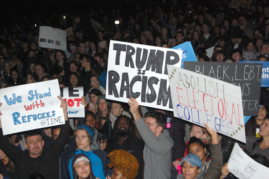 """""""We Stand With Refugees."""" """"Trump Is Racism."""" """"Abolish Electoral Colleges."""" At """"Protest Trump in Boston"""" at Boston Common, Nov. 9, 2016. (Greg Cook)"""