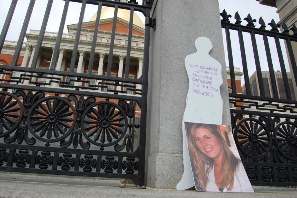 "Sign memorializing ""Katie Brannelly 23-years-old killed from complications due to crash Norwood"" at the World Day of Remembrance vigil and rally at the Massachusetts State House in Boston, Nov. 20, 2016. (Greg Cook)"