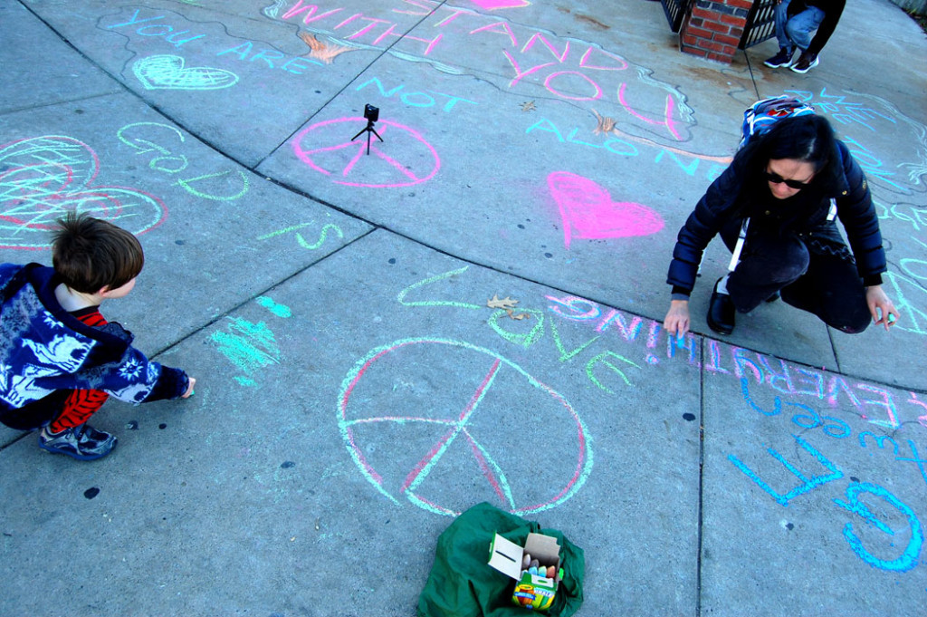 """God is Love."" MassMovement activists write on the sidewalk outside the Islamic Society of Boston Cultural Center on Malcolm X Boulevard, Boston, Nov. 18, 2016. (Greg Cook)"