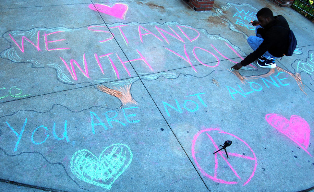 """We Stand With You."" ""You Are Not Alone."" MassMovement activists write on the sidewalk outside the Islamic Society of Boston Cultural Center on Malcolm X Boulevard, Boston, Nov. 18, 2016. (Greg Cook)"