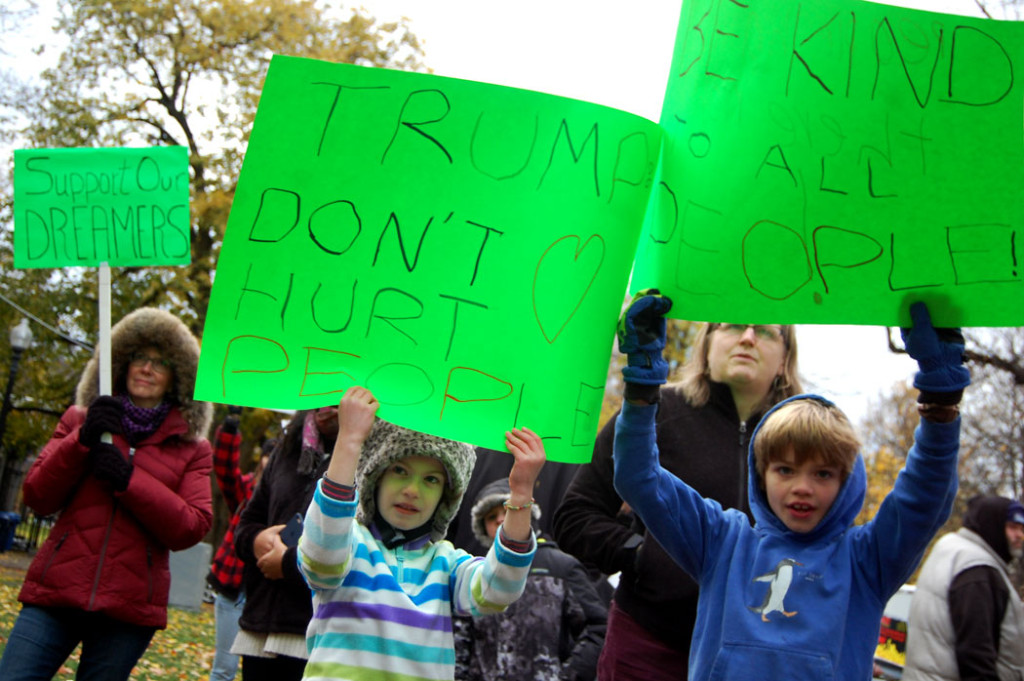 """""""Support our dreamers."""" """"Trump don't hurt people."""" """"Be kind to all people."""" At """"Love Trumps Hate"""" rally at Boston Common, Nov. 20, 2016. (Greg Cook)"""