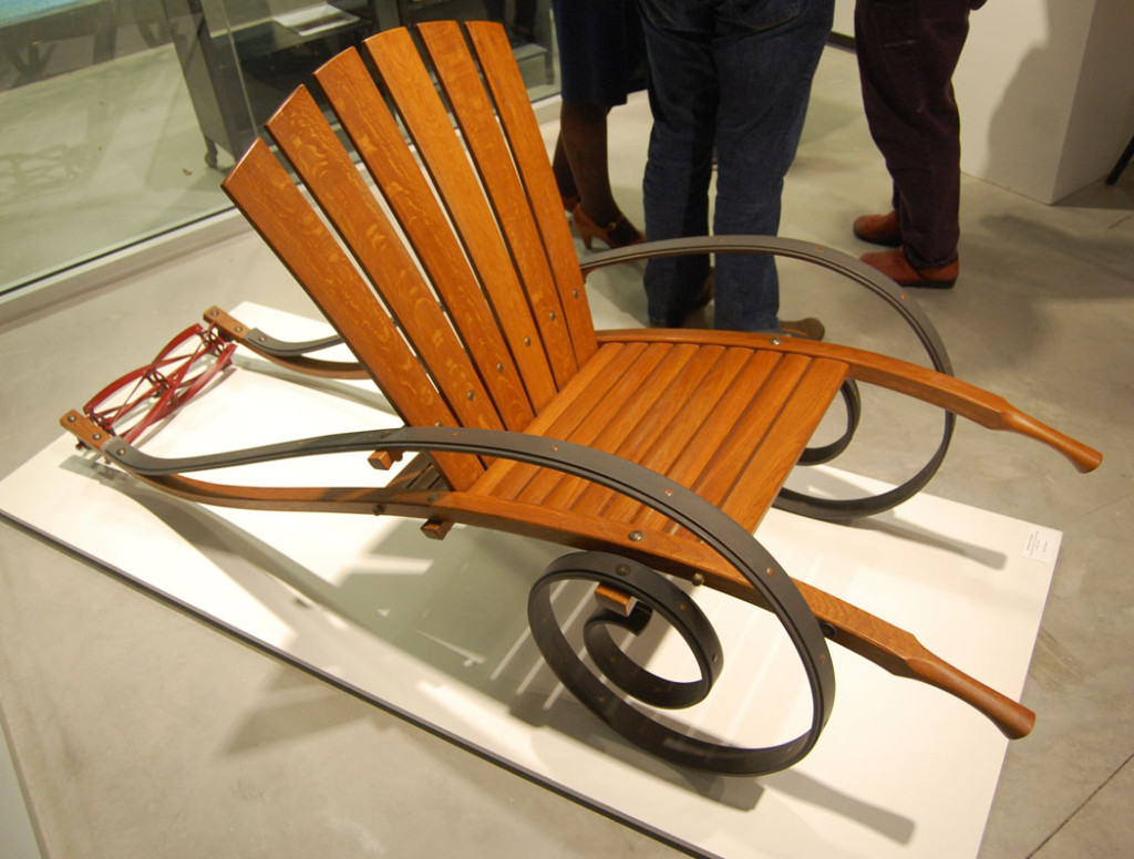 "Mitch Ryerson's ""Armchair Gardner"" (fumed oak, aluminum, lawn mower blade, copper, bronze) at ""Made in Allston,"" Nov. 12, 2016. (Greg Cook)"