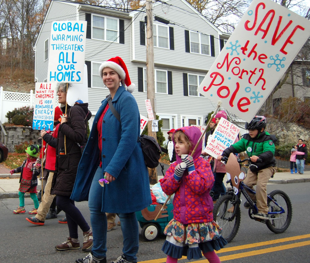 """Let It Snow! Santas Against Global Warming!"" group in Malden's annual Parade of Holiday Traditions, Nov. 26, 2016. (Greg Cook)"
