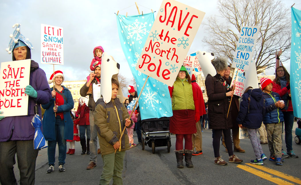 """""""Let It Snow! Santas Against Global Warming!"""" group in Malden's annual Parade of Holiday Traditions, Nov. 26, 2016. (Greg Cook)"""
