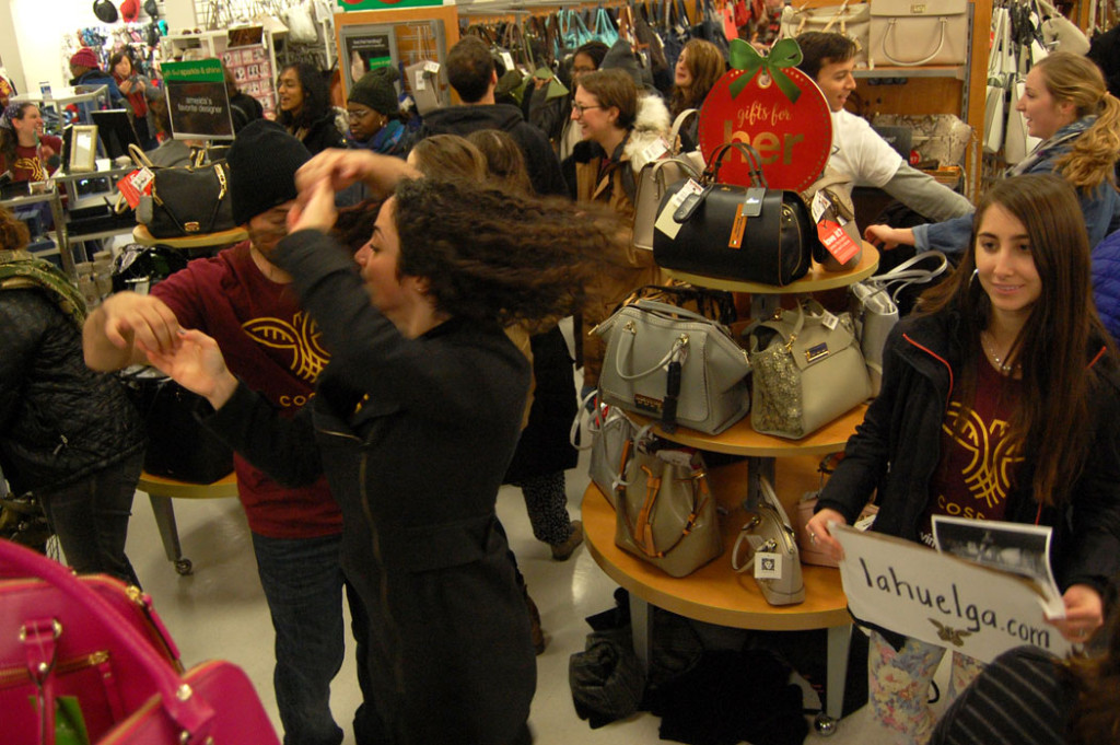 Immigrant rights protesters salsa in the aisles of T.J. Maxx. (Greg Cook)
