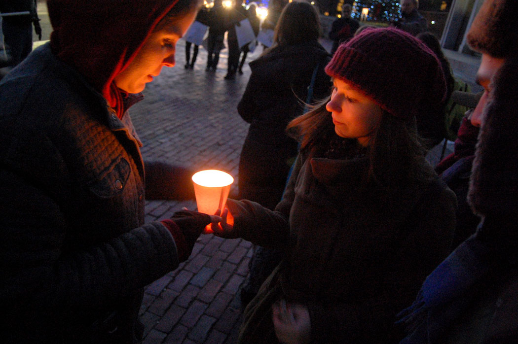 "Lighting candles at ""Protect Our White House"" rally at Massachusetts State House in Boston, Dec. 9, 2016. (Greg Cook)"