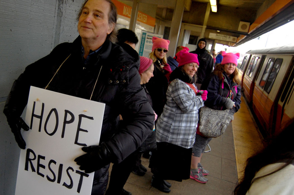 "Preparing to board the train to the ""Boston Women's March,"" Jan. 21, 2017. (Greg Cook)"