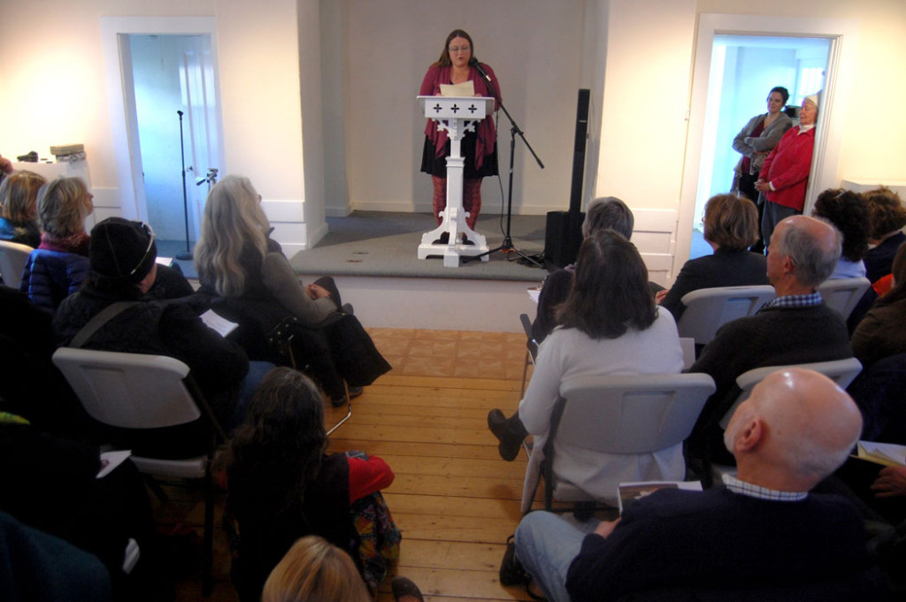 "Amanda Cook sings at the ""Writers Resist"" event at the Rocky Neck Cultural Center, Gloucester, Jan. 15, 2017. (Greg Cook)"