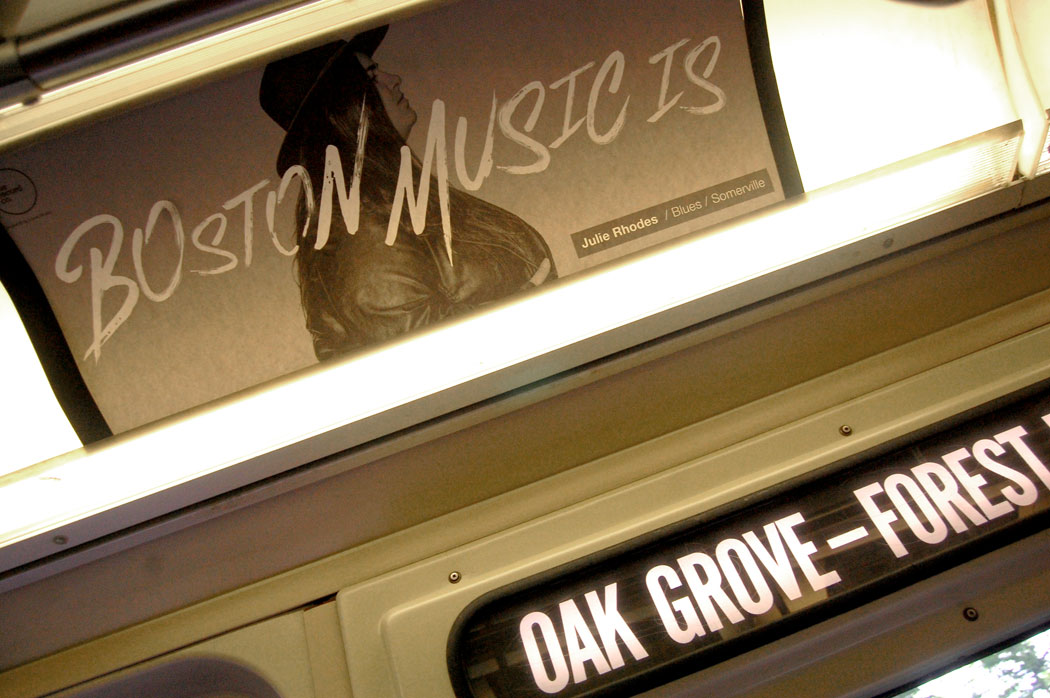 """Boston Music Is ... Julie Rhodes"" sign on MBTA Orange Line train, June 19, 2017. (Greg Cook)"