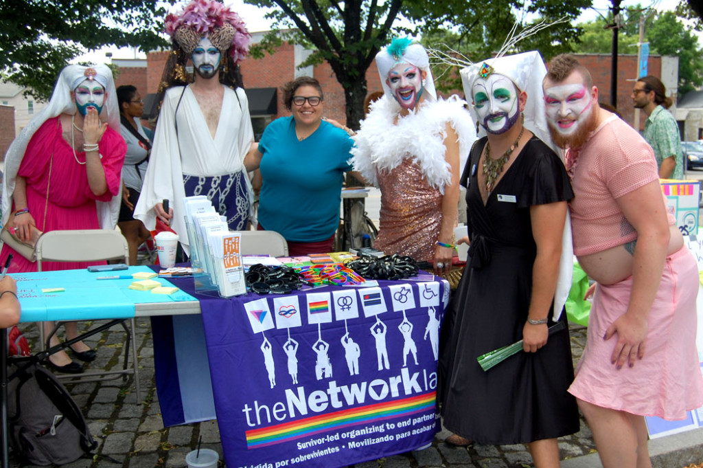 "The Boston Sisters of Perpetual Indulgence pose at the The Network/La Red table. The Sisters are the Boston branch of a gay activist group founded in San Francisco in 1979. They describe themselves as a ""modern order of nuns"" devoted to fostering joy, eliminating guilt and serving their community. ""We are the sacred clowns of our community, taking a stand on the edge of what our society defines as 'normal.'"" The Network/La Red is a survivor-led, social justice organization that works to end partner abuse in lesbian, gay, bisexual, transgender, BDSM, polyamorous, and queer communities.  (Greg Cook)"