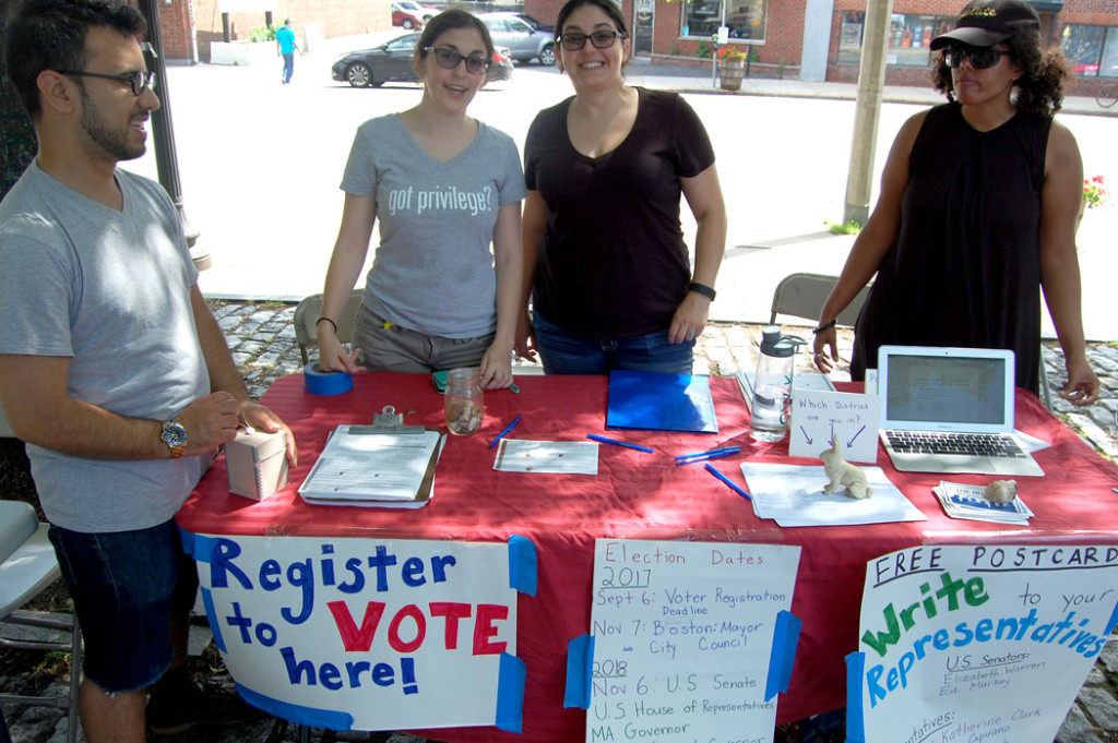 A voter registration table. (Greg Cook)