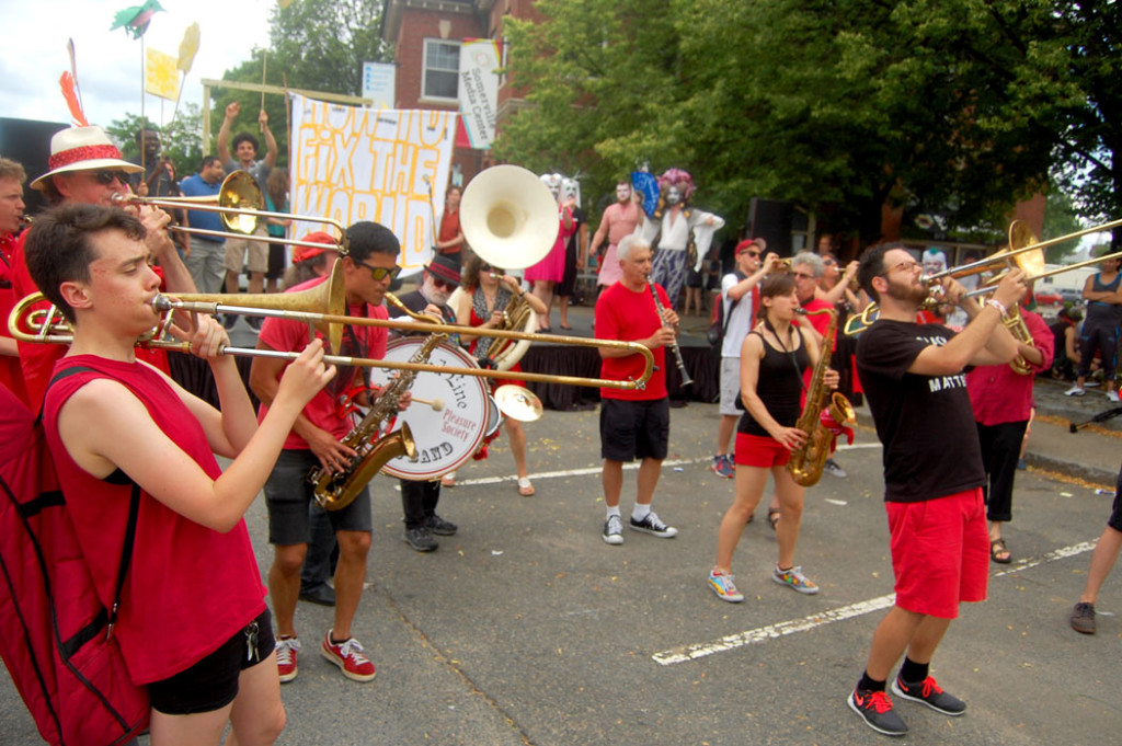 The Second Line Social Aid and Pleasure Society Brass Band plays during the festival's closing rally. The band combines music with social action, performing at protests and peace rallies, as well as helping organize Somerville's annual Honk festival of activist street bands. (Greg Cook)