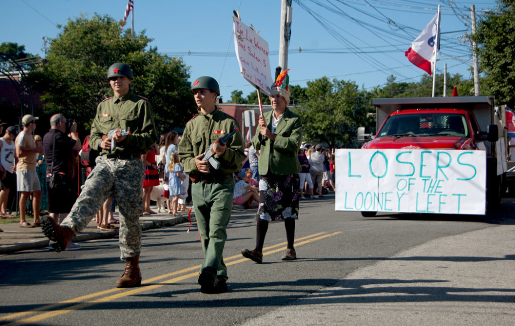 """The 2017 Beverly Farms Horribles Parade: """"Losers of the Looney Left"""" accompanied by a man dressed as """"Elizabeth Warren"""" in a feathered headdress. (Greg Cook)"""