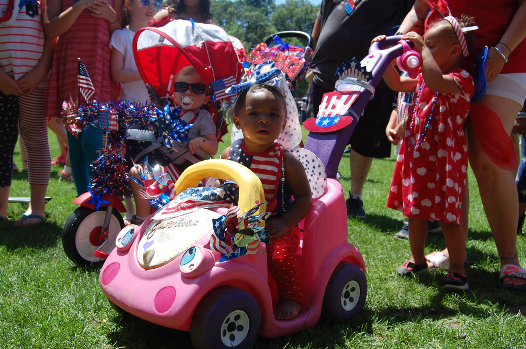 Most Patriotic Baby winner (center) at Malden's Ward 5 Independence Day party. (Greg Cook)