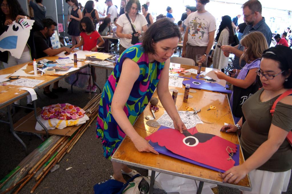 Kari Percival (center) helps visitors make bird masks at AS220's Foo Fest in Providence, Aug. 12, 2017. (Greg Cook)