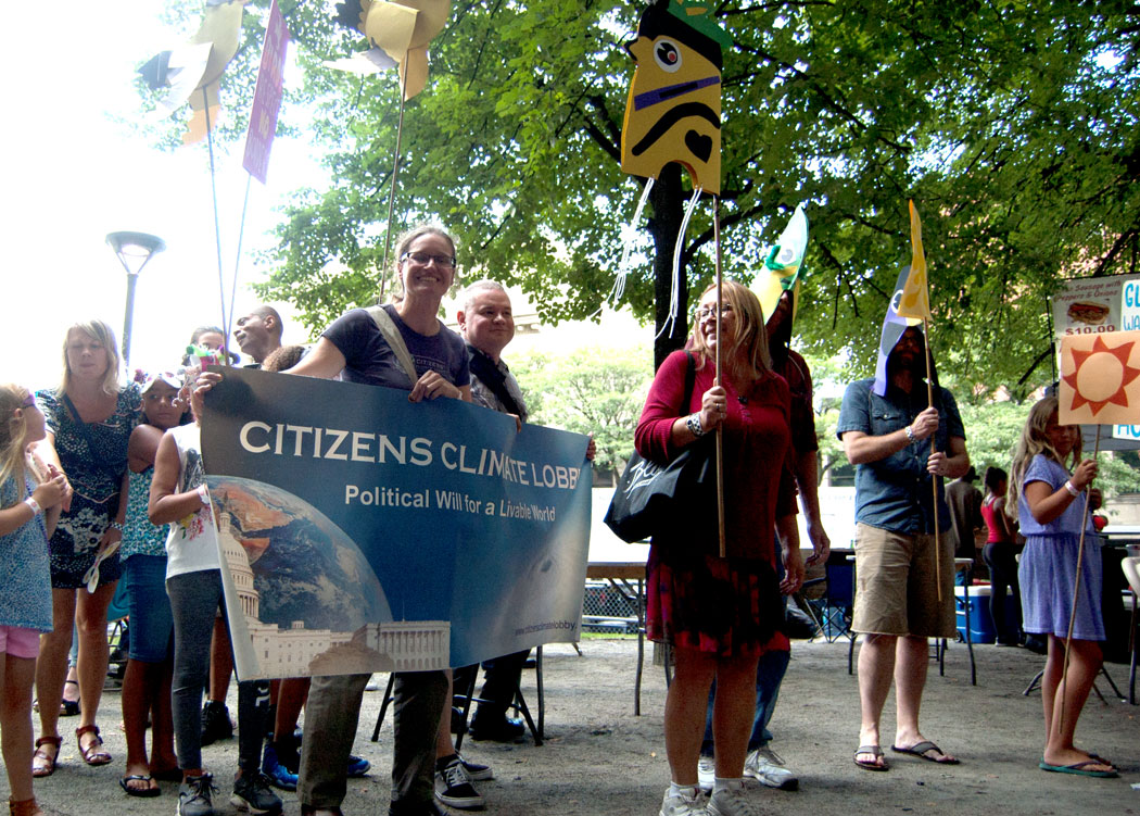 Amanda Babson of Citizens Climate Lobby Rhode Island in the Foo-topia parade. (Greg Cook)
