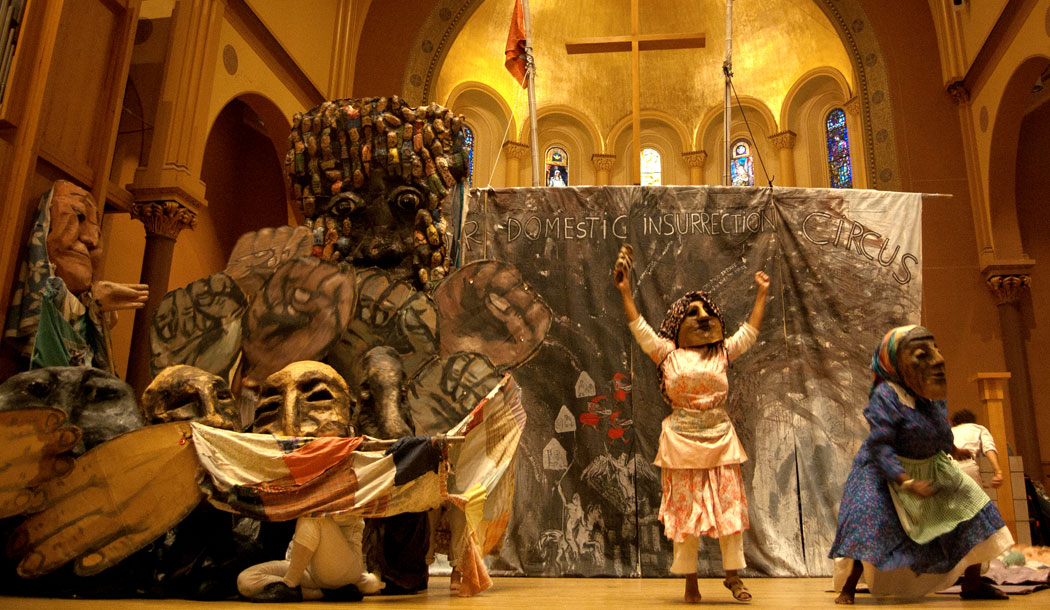 """For the liberation of Puerto Rico"" act during Bread and Puppet Theater's ""Domestic Insurrection Circus"" at First Church, Cambridge, Sept. 3, 2017. (Greg Cook)"
