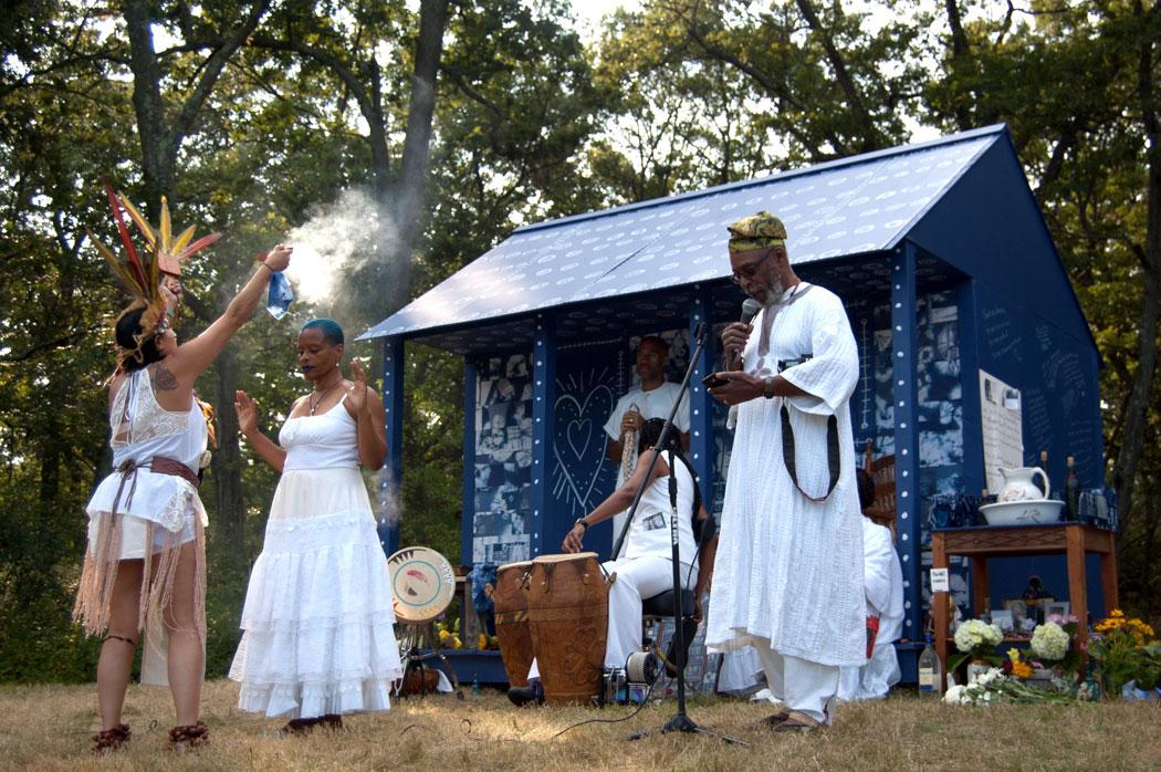 Reginald Jackson (right) leads a Yoruba prayer, Sept. 10, 2017. (Greg Cook)