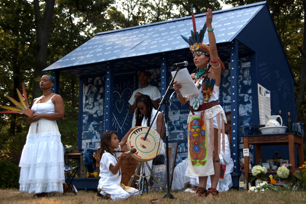 Patricia Chalinaru Dones leads a Taino prayer, Sept. 10, 2017. (Greg Cook)