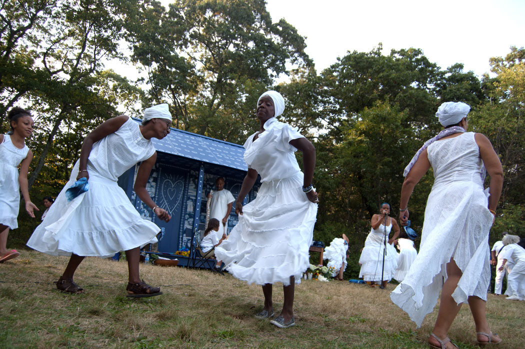 """Ife Franklin led a traditional Ring Shout dance at Boston's Franklin Park """"to celebrate the souls … and the gifts of our enslaved ancestors, the Africans who became African-Americans, who built this country. Who gave so much to us so we could be free,"""" Sept. 10, 2017. (Greg Cook)"""