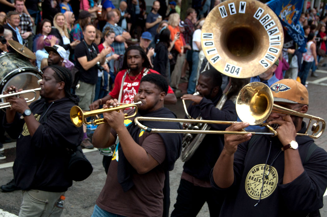 The New Creations Brass Band from New Orleans plays in the Honk Parade, Sept. 8, 2017. (Greg Cook)