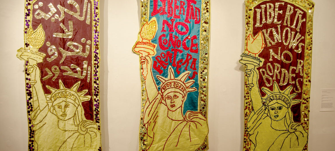 "Alexandra Zevin's ""Liberty Knows No Borders"" banners. (Greg Cook)"