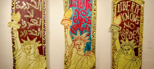 """Alexandra Zevin's """"Liberty Knows No Borders"""" banners. (Greg Cook)"""