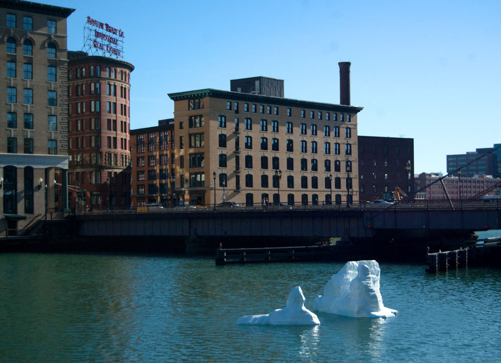 "Boston artist Gianna Stewart's ""Iceberg"" arrived in Boston's Fort Point Channel as a harbinger of the dangers of global warming, Oct. 15, 2017. (Greg Cook)"