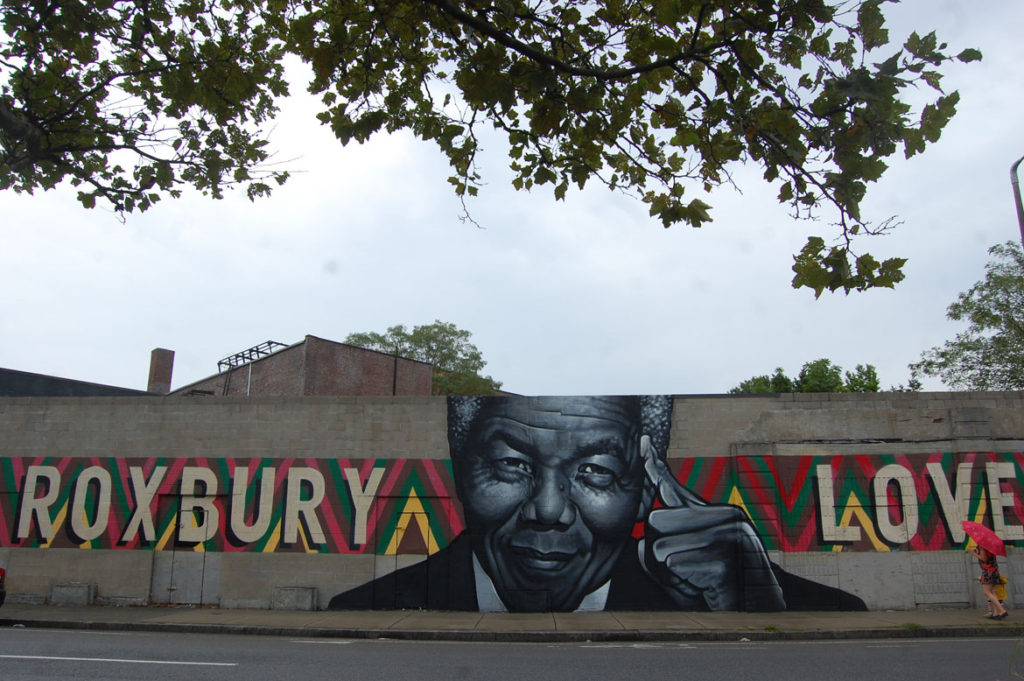 """Roxbury Love"" (Mandela) mural by Richard ""Deme5"" Gomez and Thomas ""Kwest"" Burns, 2014, on Warren Street at Clifford Street, Boston. (Greg Cook)"