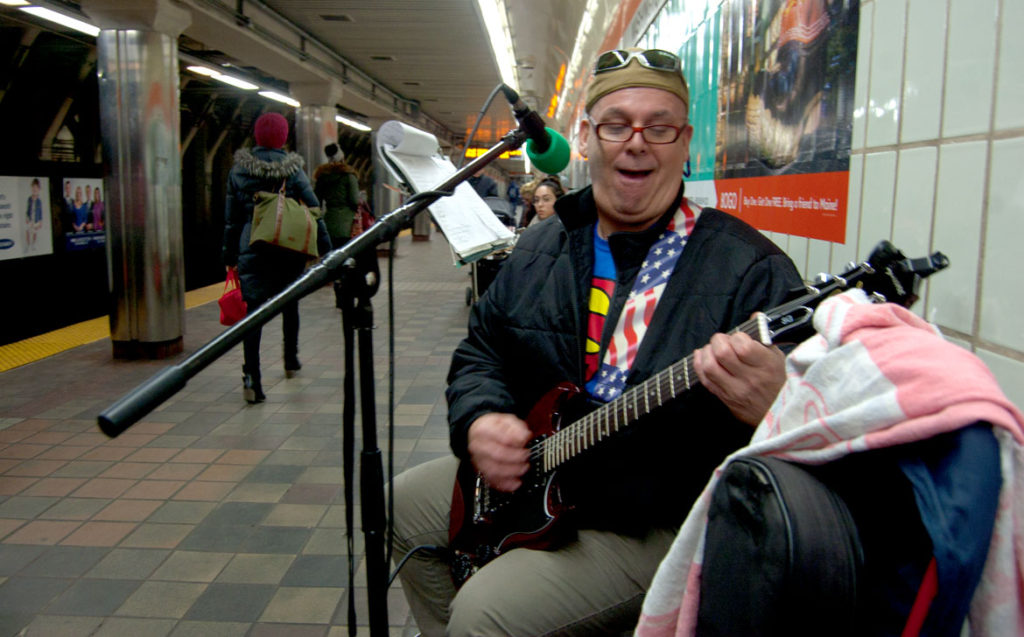 Michael Norcross plays at the Downtown Crossing MBTA stop on Dec. 20, 2017. (Greg Cook)