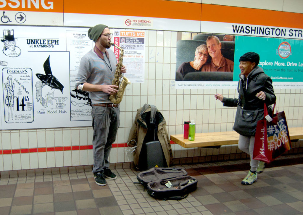 Mike Doyle performs at Boston's Downtown Crossing MBTA Station, Dec. 6, 2017. (Greg Cook)