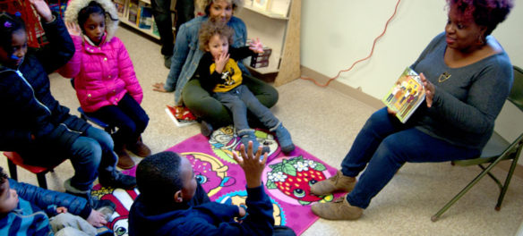 Tanya Nixon-Silberg of Wee The People leads a social justice story time at the Frugal Bookstore in Roxbury, Dec. 16, 2017. (Greg Cook)