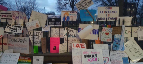 2017 Boston Women's March signs left along the iron fence of theCentral Burying Ground at Boston Common. (Nathan Felde)