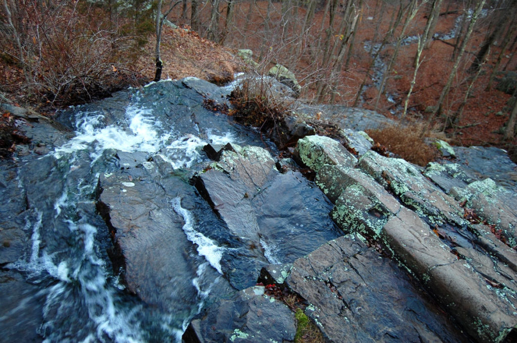Atop the Cascade falls, looking over the edge as the brook runs toward Washington Street, in the Middlesex Fells, Melrose, December 2015. (Greg Cook)