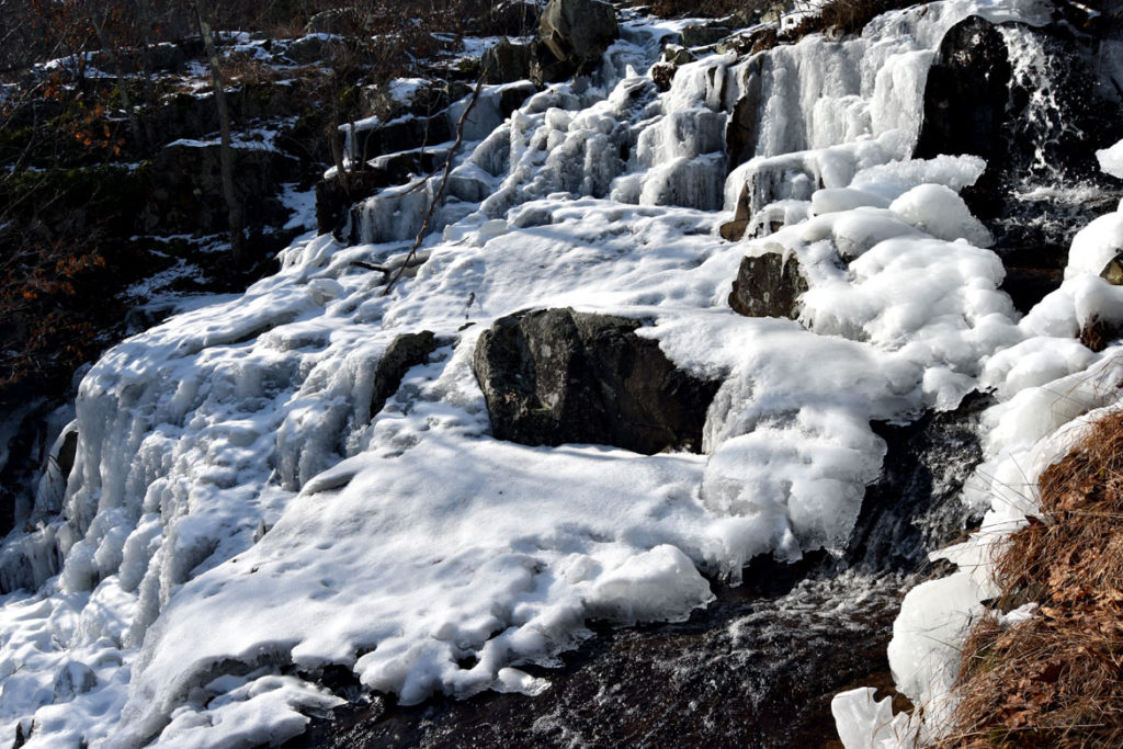 Water still runs under the frozen Cascade in the Middlesex Fells, Melrose, Jan. 21, 2018. (Greg Cook)