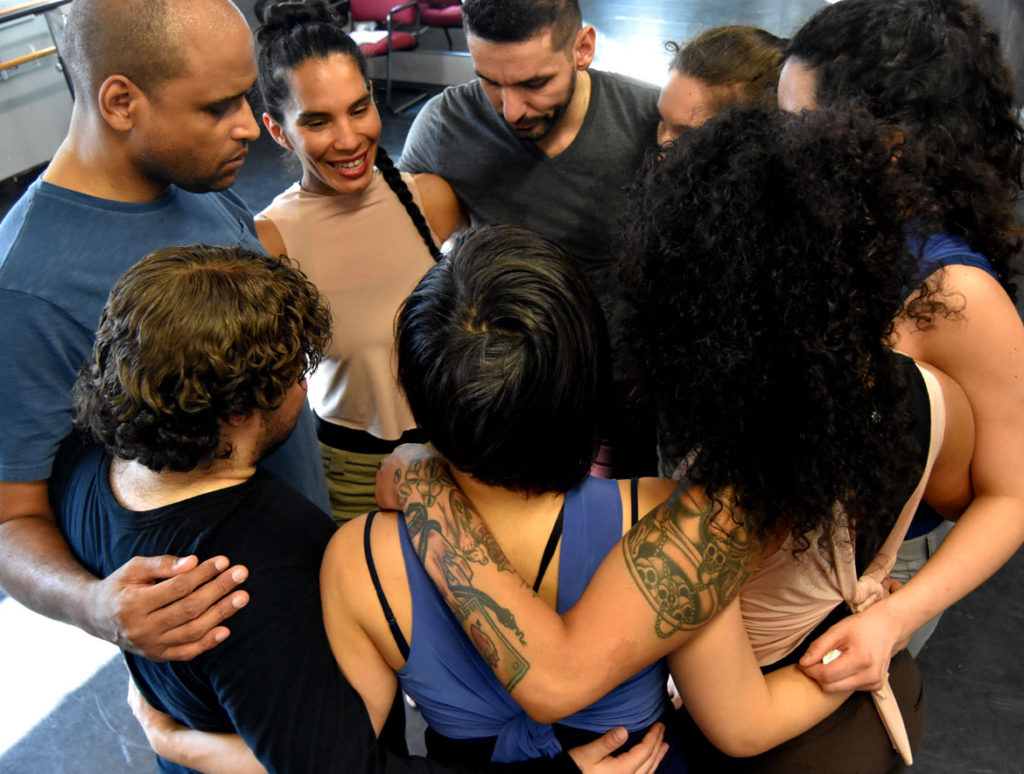 "Danza Organica members huddle up at the end of their rehearsal of ""Melaza,"" Jan. 10, 2018. (Greg Cook)"