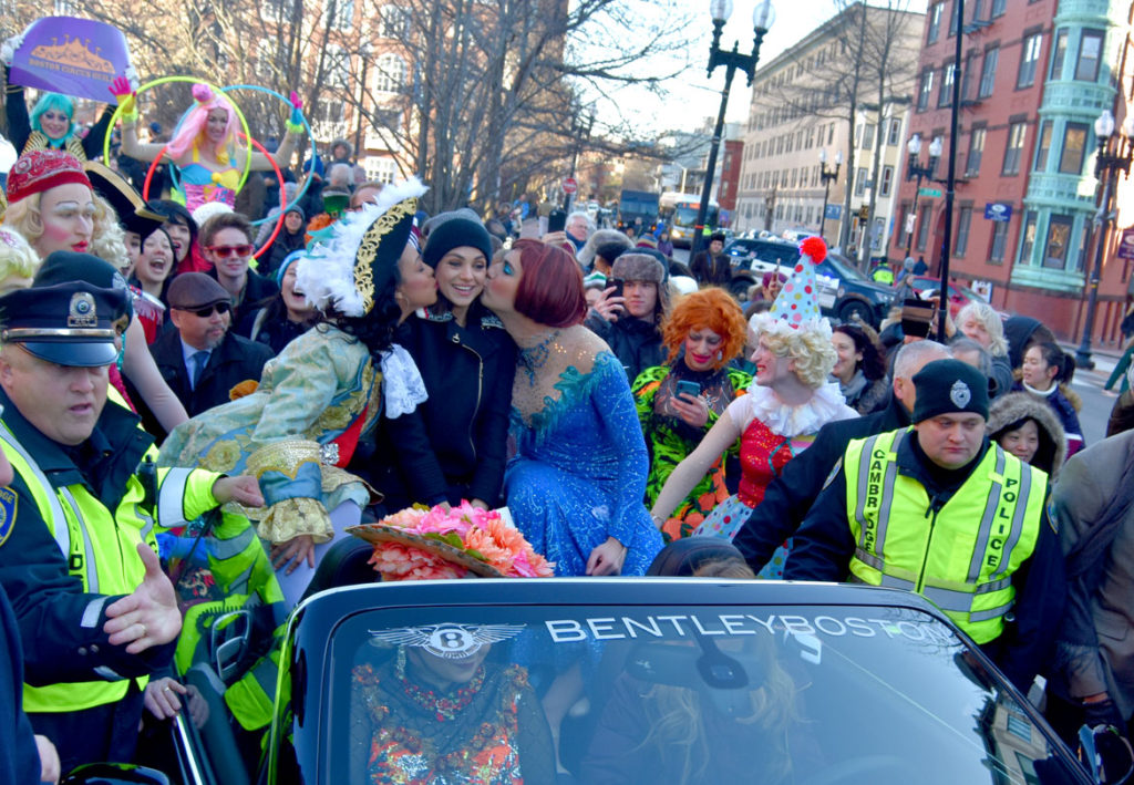 Hollywood actor Mila Kunis appears in Harvard's Hasty Pudding's Woman of the Year Parade down Massachusetts Avenue in Cambridge, Jan. 25, 2018. (Greg Cook)