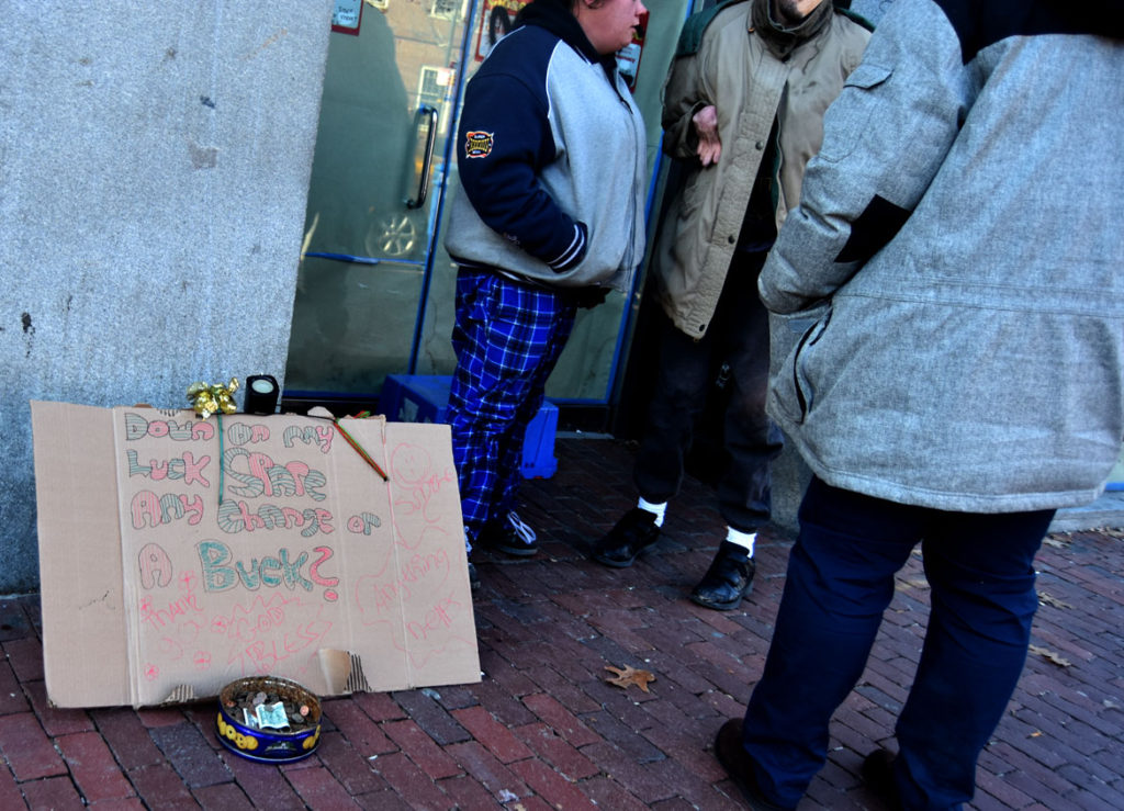 """Down on my Luck Spare Any Change or a Buck? Thank you. God Bless. Smile. Anything helps."" Harvard Square, Cambridge, Jan. 26, 2018. (Greg Cook)"