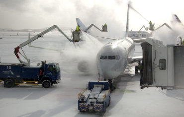 De-icing a jet at Boston's Logan Airport, Dec. 25, 2017. (Greg Cook)