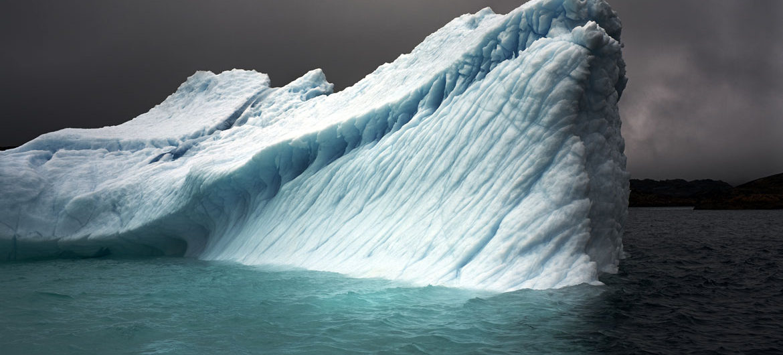 "Camille Seaman ""Breaching Iceberg, Greenland,"" Aug. 8, 2008. (Courtesy)"