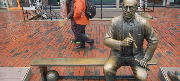 "Statue of ""Red"" Auerbach at Faneuil Hall. (Greg Cook)"