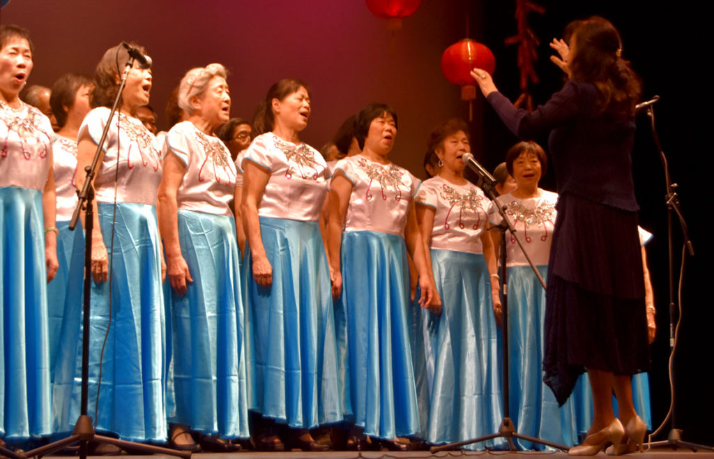 Senior Center singers at Chinese Lunar New Year Celebration at Malden High School, Feb. 10, 2018. (Greg Cook)